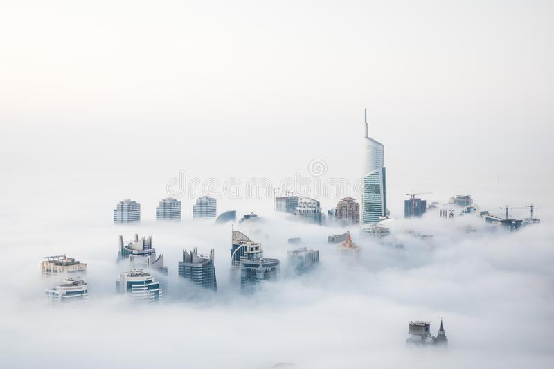 World`s tallest skyscrapers in dense fog during a winter morning. When cold desert air meets warm ocean air, Dubai witnesses a unique phenomenon that sees even royalty free stock photos
