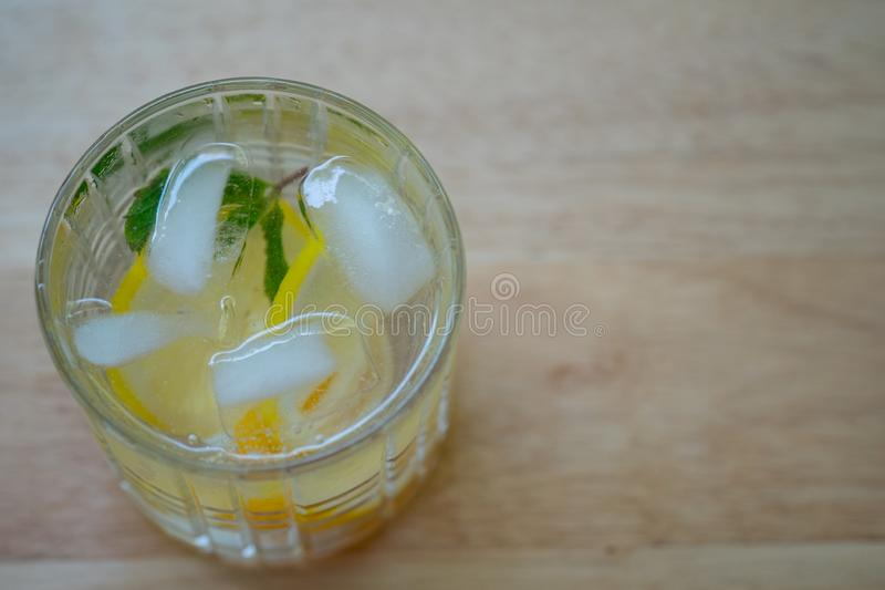 Cold detox water with lemon. Summer refreshing drink royalty free stock images