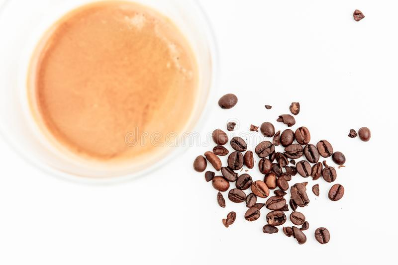 Cold Dried Coffee Beans Next To Hot Coffee Drink stock images