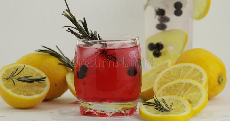 Cold drink in drinking glass. Refreshing soda lemonade red cocktail with lemon stock photos
