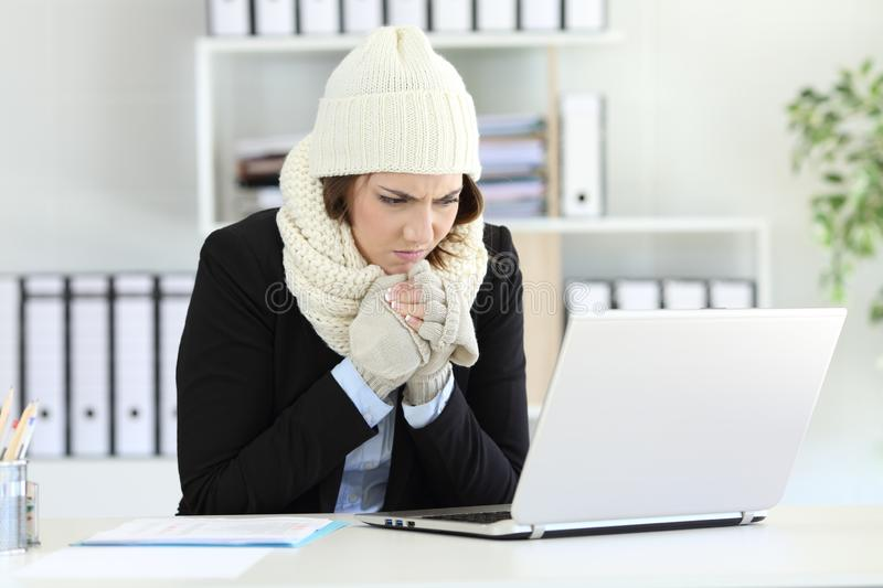 Cold executive working with a heater failure in winter royalty free stock photography