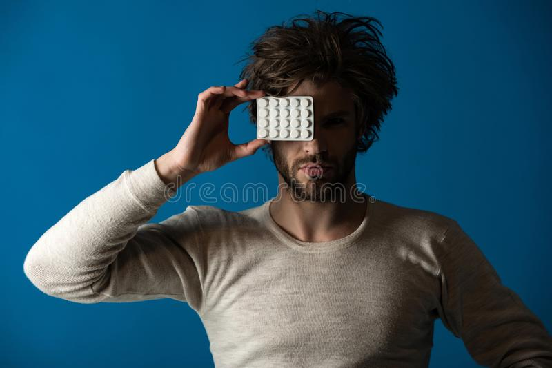 Cold, flu and headache treatment, hypnotic tablet. Drug and antidepressant, insomnia. Health and medicine, hangover. Dieting pill and vitamin, man with royalty free stock photography