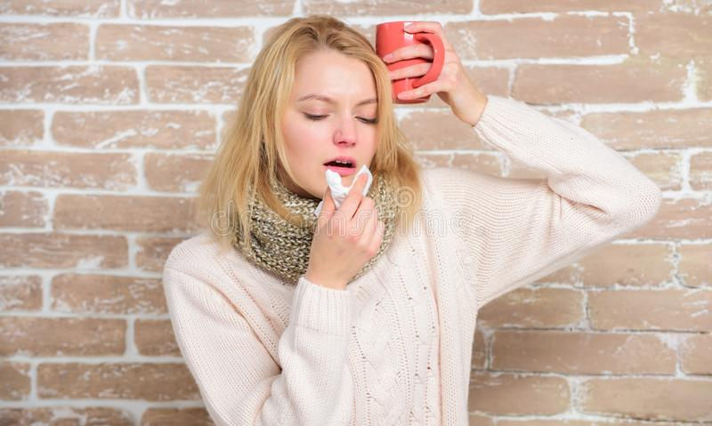 Cold and flu remedies. Drink more liquid get rid of cold. Girl hold tea mug and tissue. Runny nose and other symptoms of. Cold. Drinking plenty fluid important royalty free stock photo