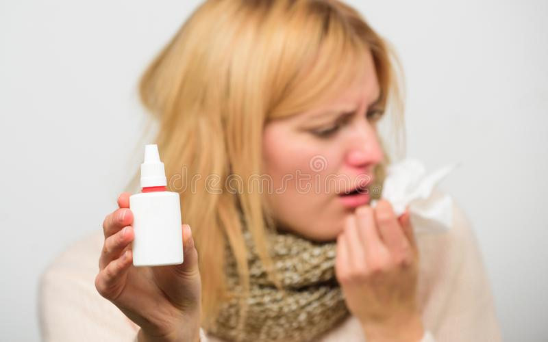 Cold and flu remedies. Runny nose and other symptoms of cold. Nasal drops bottle. Nasal spray runny nose remedy. Woman royalty free stock photos
