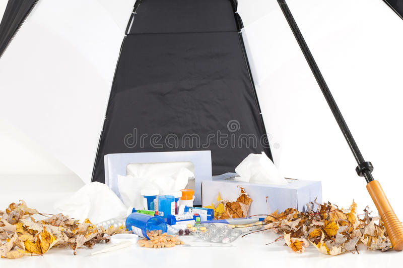 Cold And Flu Season With Umbrella_Landscape Royalty Free Stock Images
