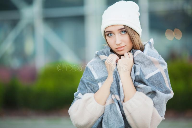 Cold and flu. Woman get sick and cough, wearing autumn clothes.  stock photo