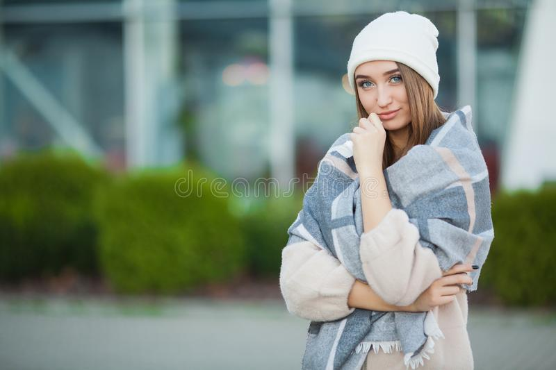 Cold and flu. Woman get sick and cough, wearing autumn clothes.  royalty free stock image