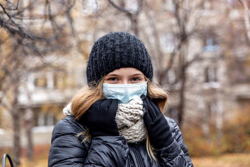 Cold and flu. Woman with a medical face mask. Outdoor royalty free stock photo