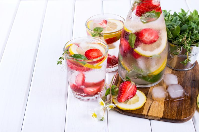 Cold fresh homemade lemonade with strawberry and herbs. Detox soda water. Recipe stock image