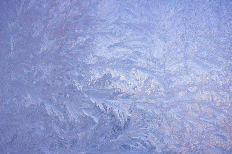 Cold frost patterns on glass stock image