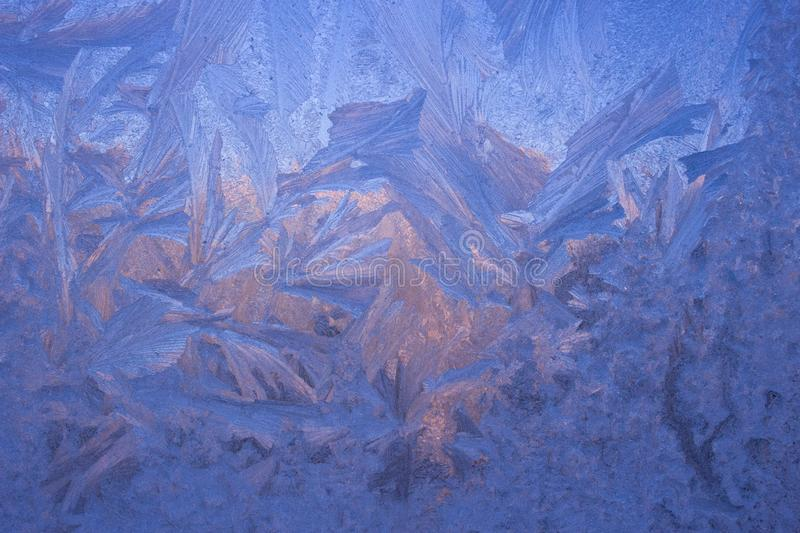 Cold frost patterns on glass royalty free stock image
