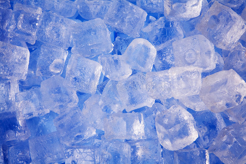 Cold frosty ice cubes on blue background