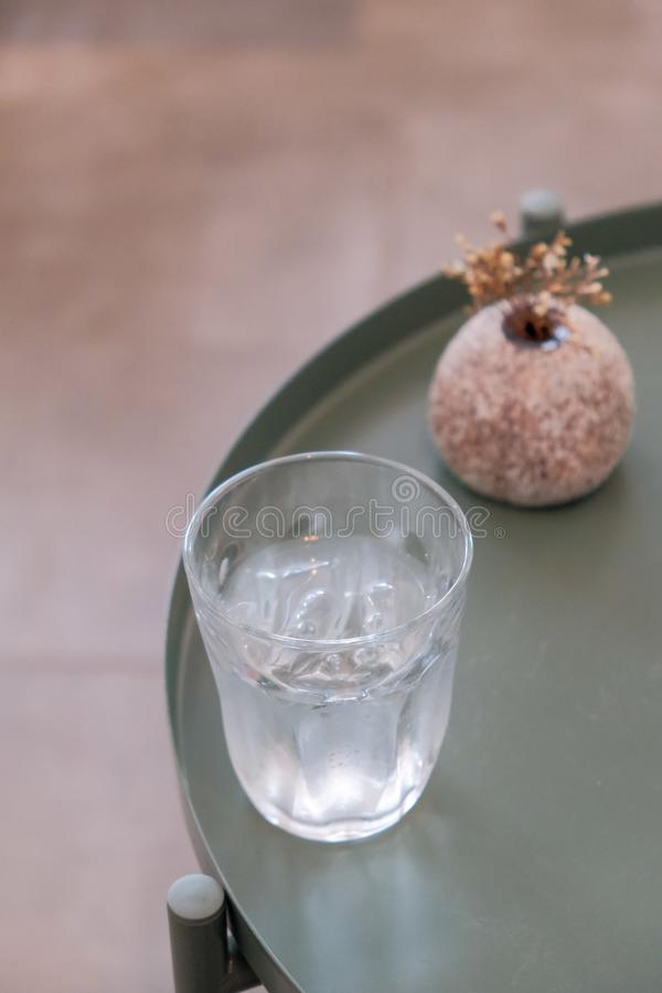 Cold glass of water on wooden table. At cafe royalty free stock image