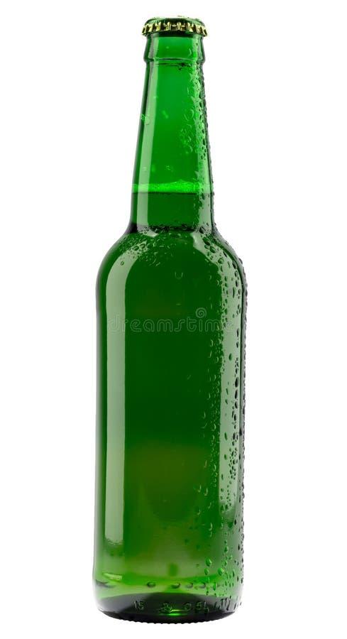 Cold green beer bottle on black stock images