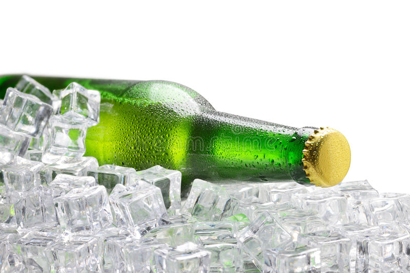 Cold green bottle of beer royalty free stock photo