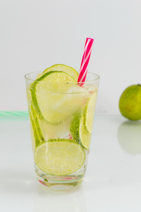Cold green lime juice with ice cubes. For a hot summer day royalty free stock photography