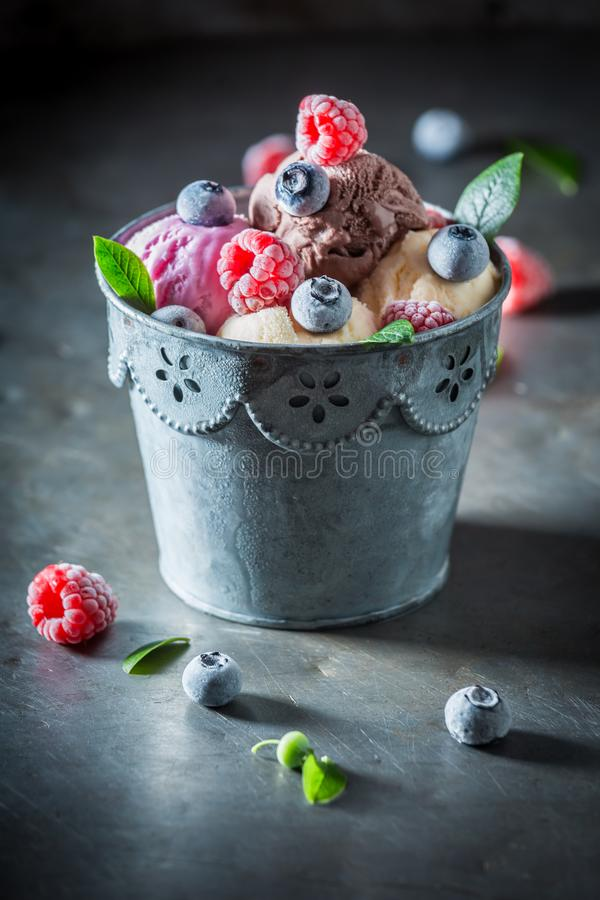Cold ice cream with fresh blueberries and raspberries royalty free stock photo