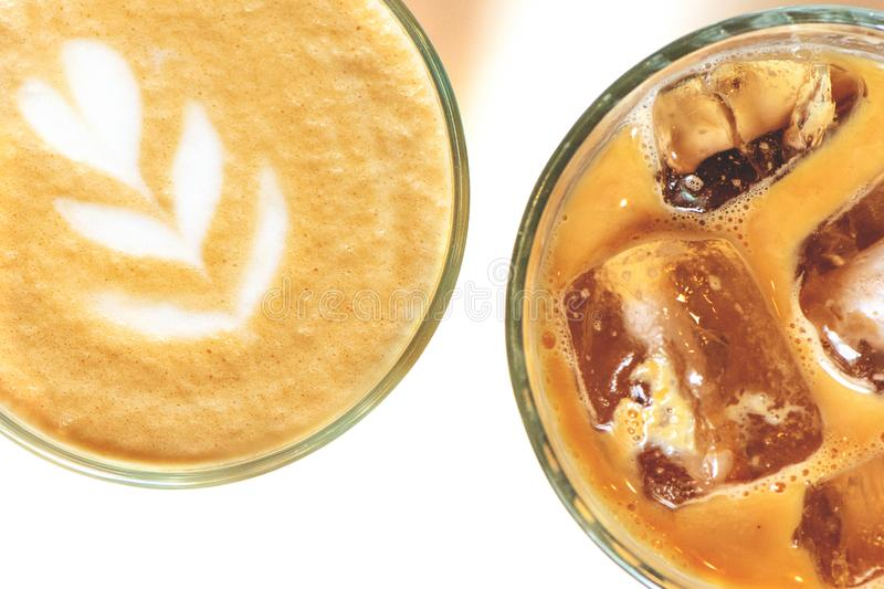 Cold ice latte and coffee with latte art in a glass on a white background. stock images