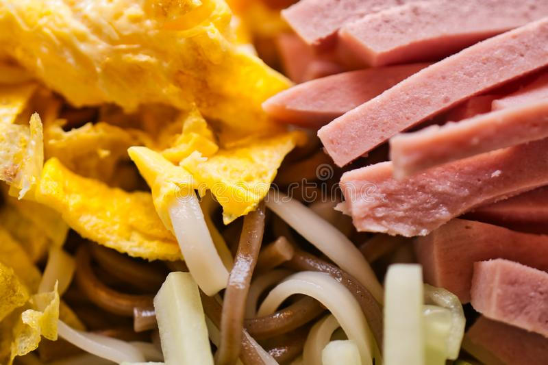 Cold Japanese soba noodles with sliced omelette and fine cooked sausage, traditional Japanese food in summer royalty free stock image
