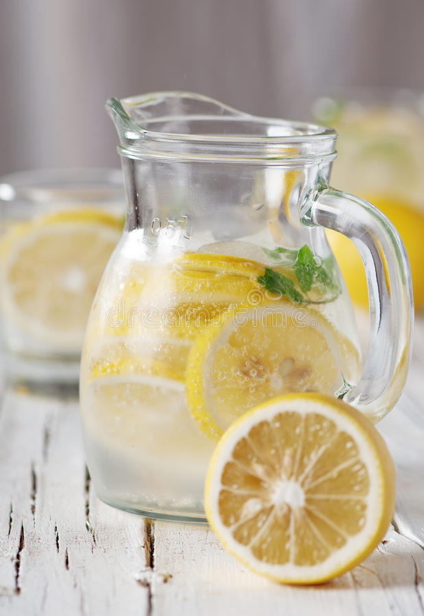 Cold lemon water. With ice and mint, selective focus royalty free stock photo