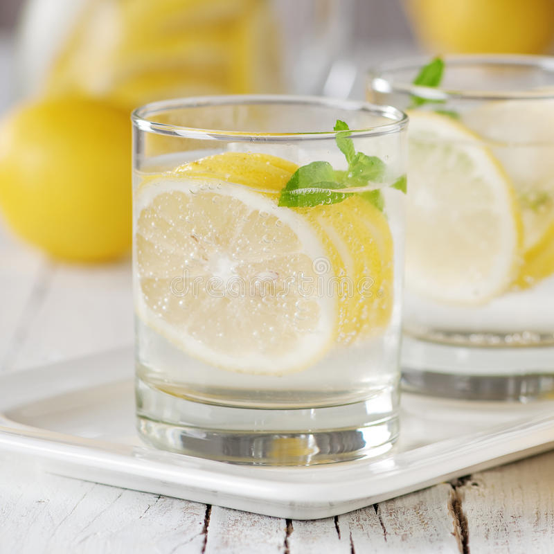 Cold lemon water. With ice and mint, selective focus and square image royalty free stock image