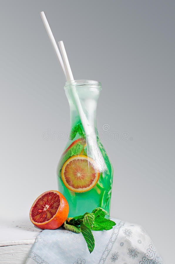 Cold lemonade in the decanter royalty free stock photo