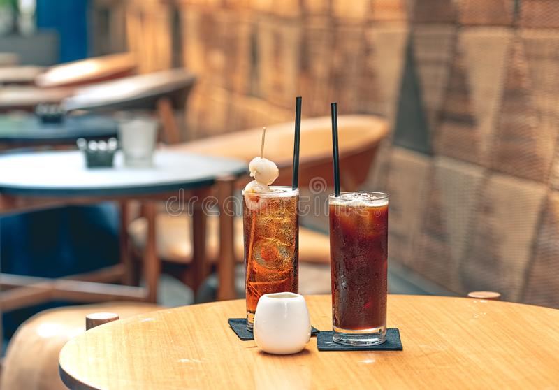 Cold Lychee Iced Tea on The Wooden Table at Hot Tropical Restaurant. Selective Focus royalty free stock photo