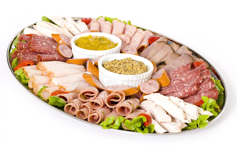 Cold Meat Catering Platter. With sliced chicken breast, mortadella, salami, roast beef, ham, turkey, cabana sausage and seeded wholegrain mustard and sweet stock photo