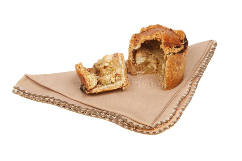 Cold meat pie on a serviette. Isolated against white royalty free stock photo