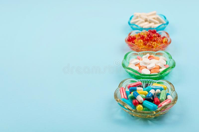 Cold medicine, health care, traditional medicine and flu concept. Various multi-colored pills and capsules, treatment of colds,. Flu and runny, bio, cough, cure royalty free stock image