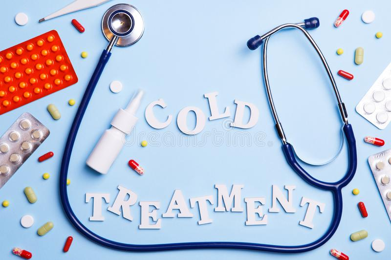 Cold medicine, thermometer, phonendoscope and text Treatment cold royalty free stock photography