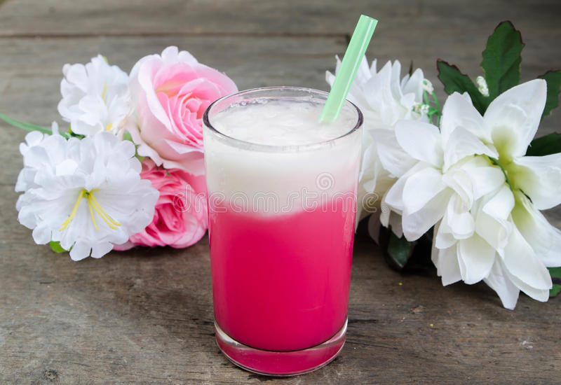 Cold milk pink in the glass stock photo