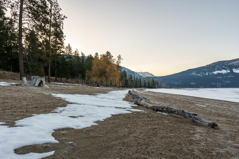 Cold morning landscape of frozen Little Shuswap Lake British Columbia Canada stock images