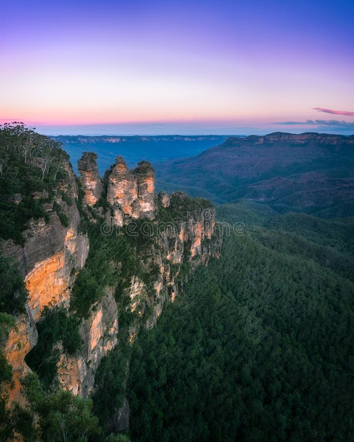 Cold morning but warm sunrise colors in the sky at Three Sisters stock image