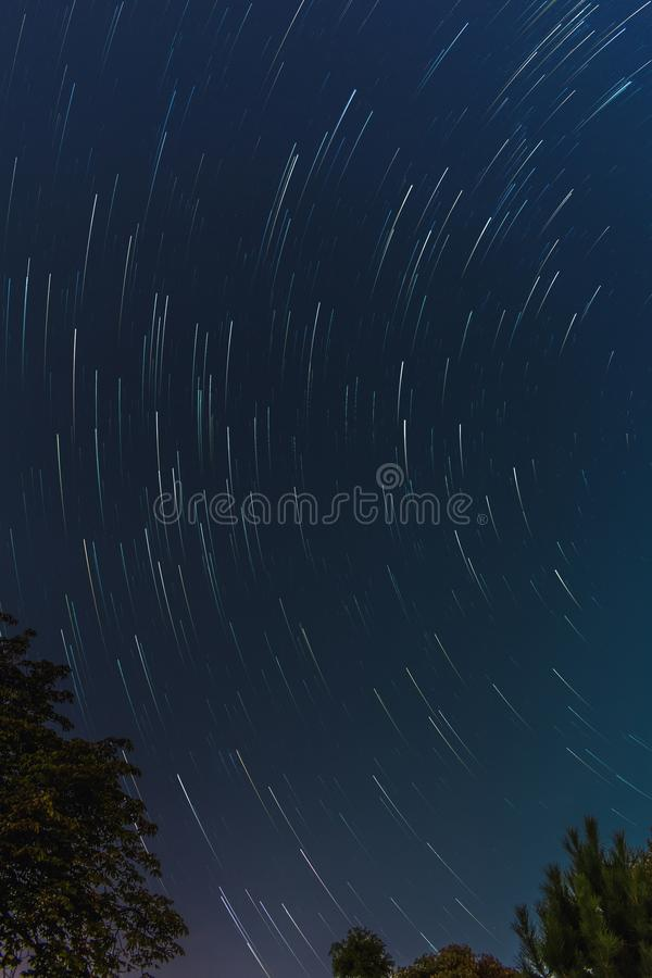 Star Trails In Melbourne Garden In Midnight Time stock photo