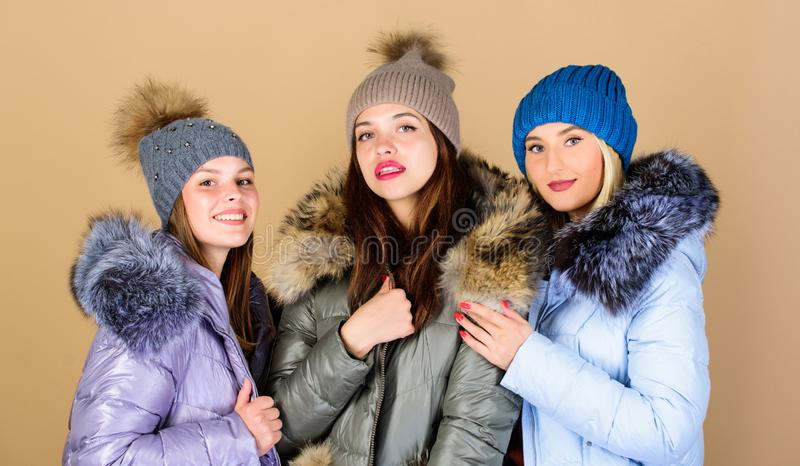 It is cold outside. women in padded warm coat. family christmas. happy winter holidays. Friendship. flu and cold. Seasonal shopping. winter clothing fashion royalty free stock photos