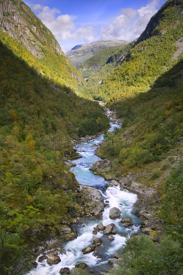 Cold river in mountain valley stock photography