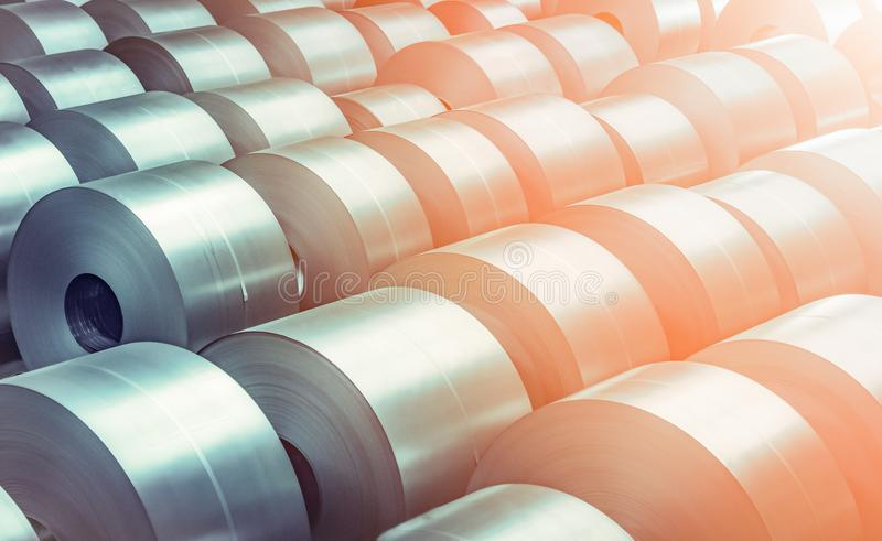 Cold rolled steel coil at storage area in steel industry plant. Vintage blue tone stock photos