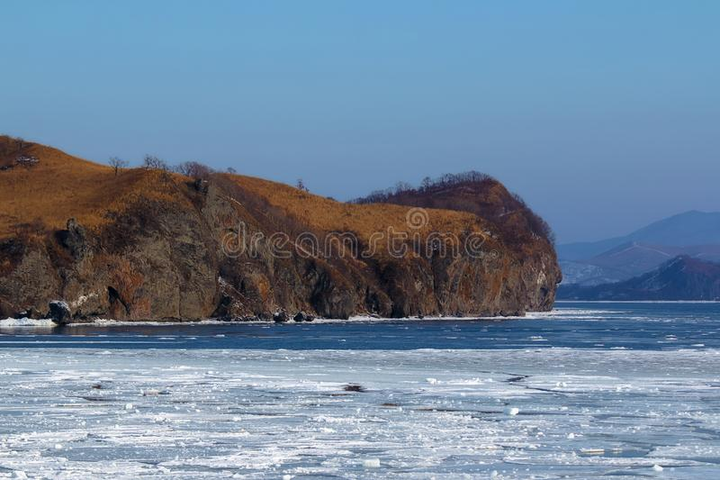 Rocky Cape near the freezing sea in winter stock image