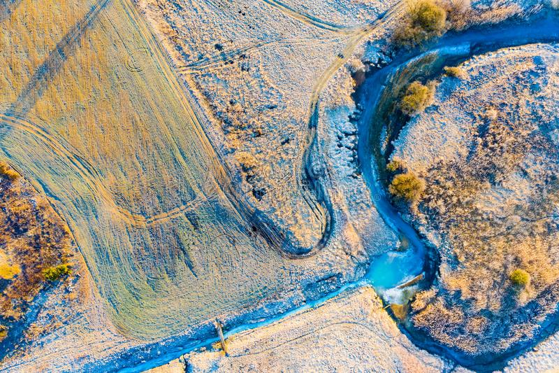 Cold season. Frosty morning in countryside. Sun shining bright over rural area royalty free stock image