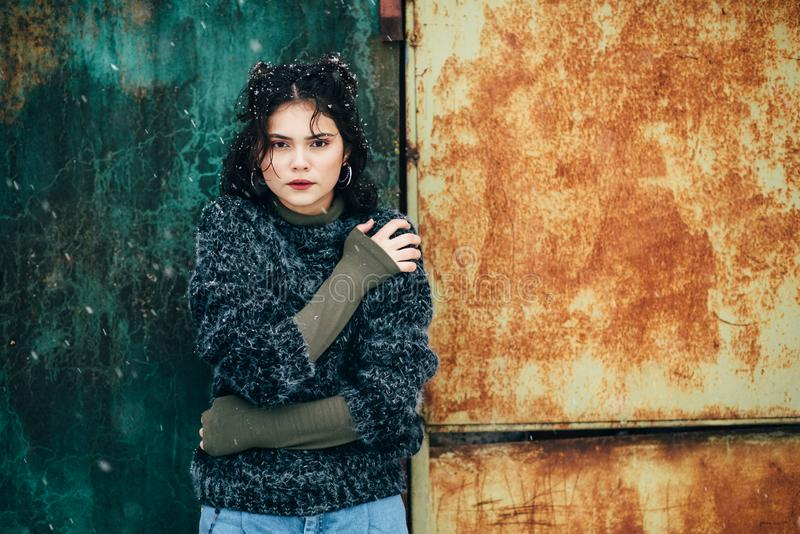 Winter portrait of a pretty girl without outerwear. Cold season. Winter portrait of a pretty girl without outerwear royalty free stock images