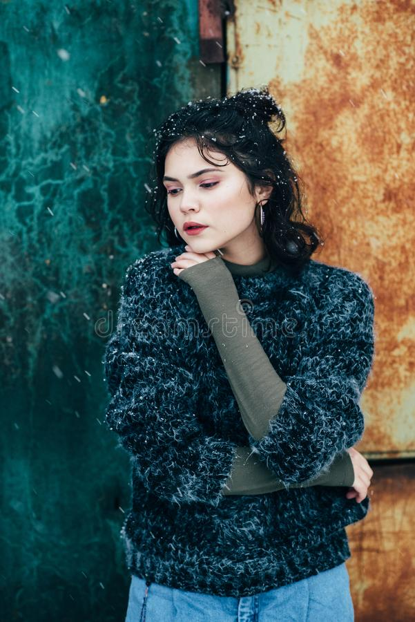 Winter portrait of a pretty girl without outerwear. Cold season. Winter portrait of a pretty girl without outerwear stock images