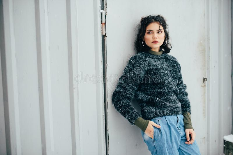 Winter portrait of a pretty girl without outerwear. Cold season. Winter portrait of a pretty girl without outerwear royalty free stock photography