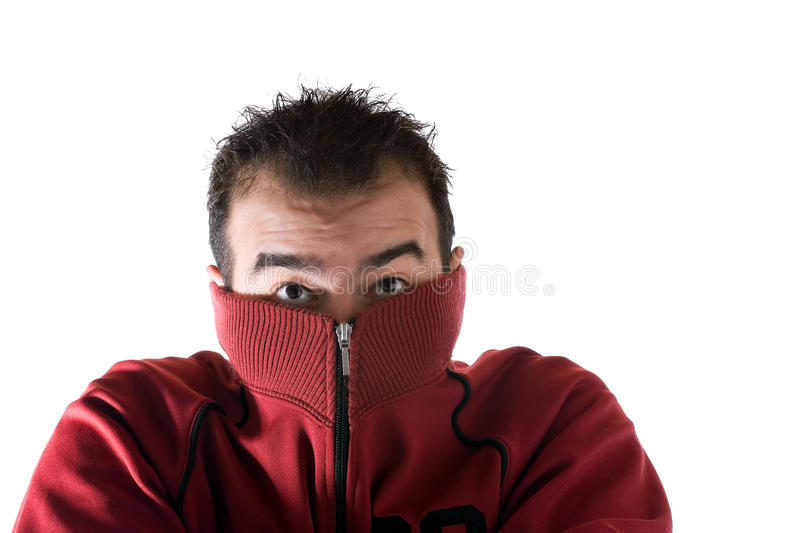 Cold Shivering Man. A cold man shivering and burying his face into his sweater. A great concept for HVAC stock photos