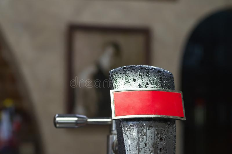 Cold silver beer tap with condensation stock photo