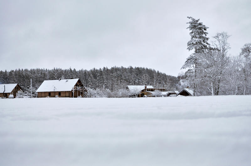 Cold snowy winter landscape of rural homes. stock photo