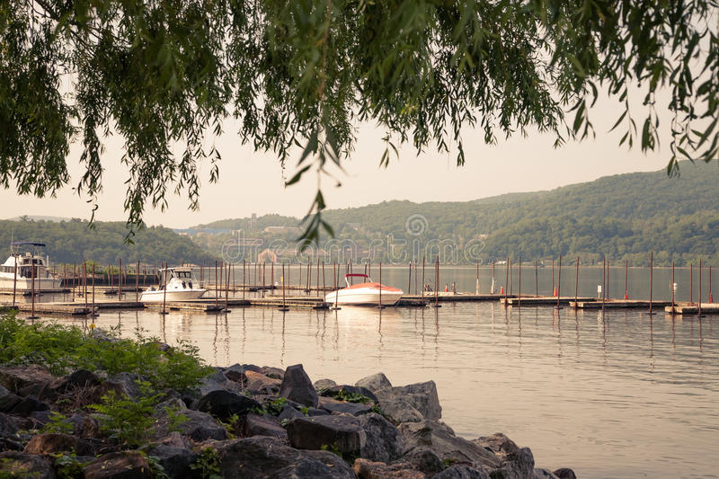 Cold Spring. Early morning view of boat dock in Cold Spring, Putnam County, New York. West Point Military Academy is across the river stock photography