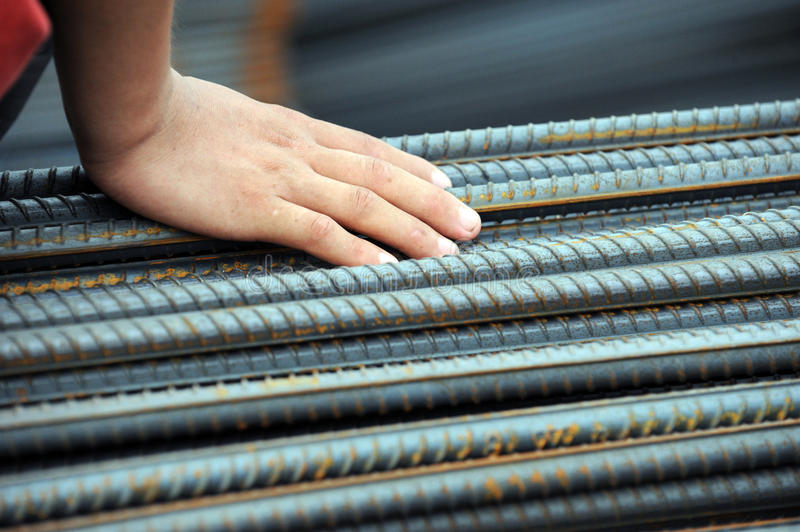 Cold steel. Human's hand on cold steel bars . abstract macro with shallow depth of field stock photos