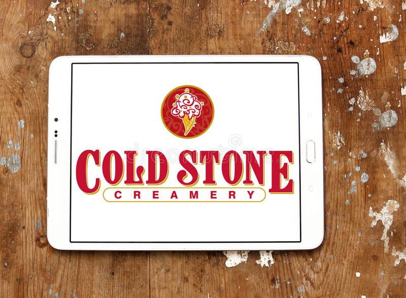 Cold stone Creamery restaurant logo. Logo of cold stone Creamery restaurant on samsung tablet on wooden background royalty free stock image