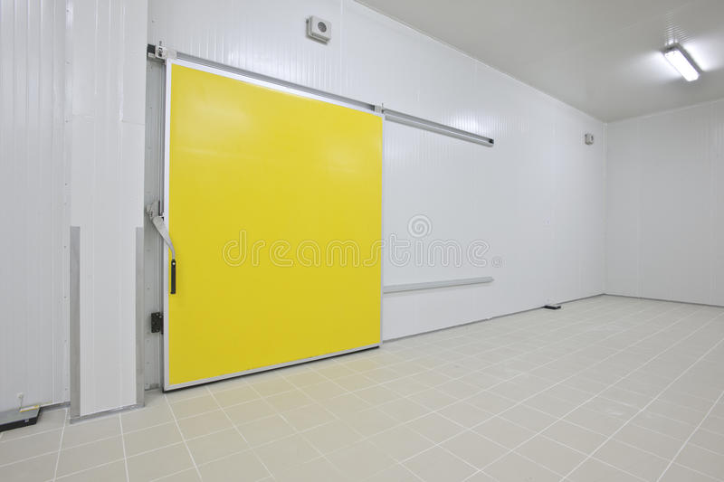 Cold storage. Empty storage in a meat processing factory. Big Industrial refrigerator or dryer for any kind of food, meat, fruit or vegetable. From -10 to -80 royalty free stock photo